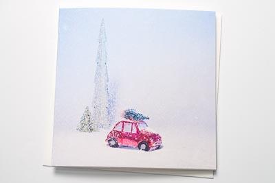 Weihnachtskarte Auto im Schnee